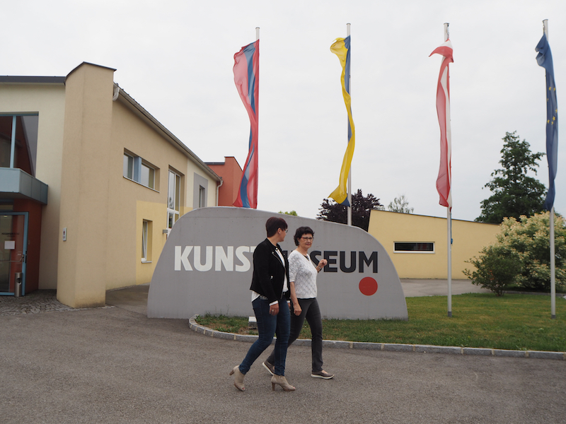 Ruth Schremmer, of Kunstmuseum Waldviertel, and Tanja Seegelke engaged in a lively discussion in front of the museum in Schrems, Waldviertel.